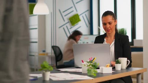 Enthusiastic Woman Manager Typing on Laptop Browsing on Internet