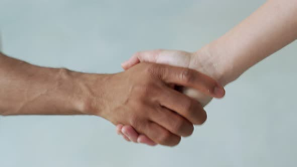 White and Black Hand Connect. Anti-racism. Stop Racism, All People Are Equal. Friendship of Peoples