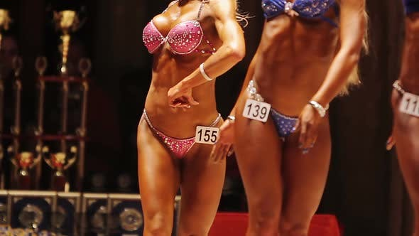 Thumbnail for Three Finalists of Bodybuilding Competition Standing on Stage, Women in Bikinis