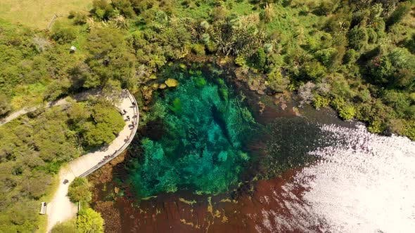 Thumbnail for Aerial view of people visiting Mirror Lakes, observation deck, New Zealand.