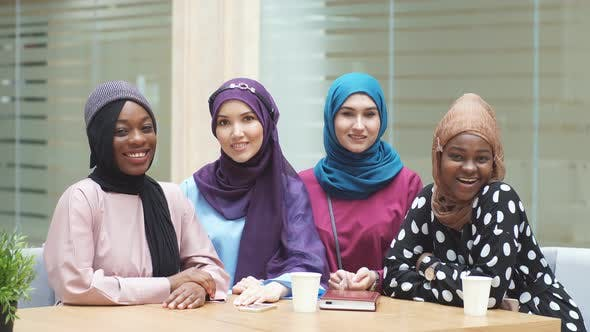 Thumbnail for Muslim Multiethnic Female Representatives Posing in Lobby of Business Centre