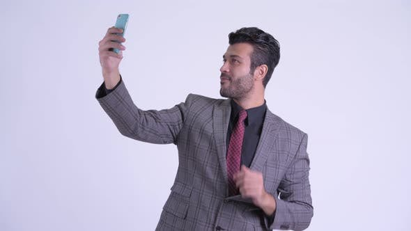 Thumbnail for Happy Bearded Persian Businessman Taking Selfie with Phone