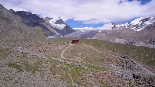 Thumbnail for Aerial travel drone view of Zermatt at the Stellisee Lake, Mount Matterhorn, Switzerland.