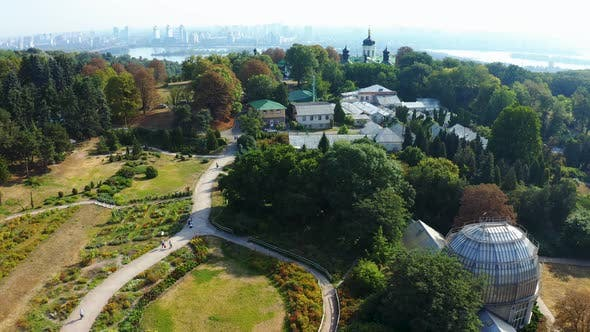 Botanical Garden in Kiev in Summer From a Height, People Walk in the Park with Flower Beds