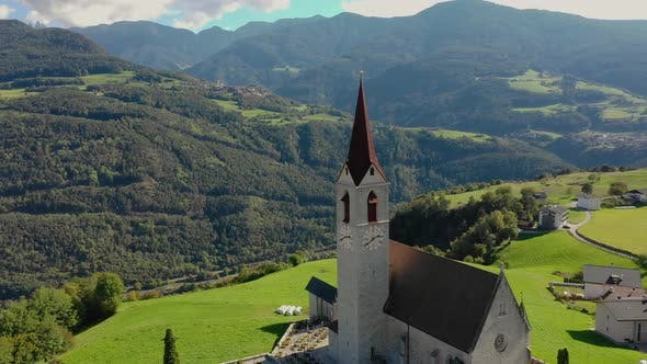 Thumbnail for A Bird's-eye View of the Church and the Valley Near the Village of Velturno. Dolomites. Autumn Italy