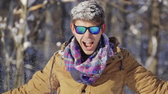 Thumbnail for Happy Teenager Throwing Snow Up in Front of Camera. Winter Mood. Winter, Sport, Holidays, Xmas