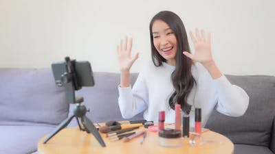 Young asian woman online review cosmetic