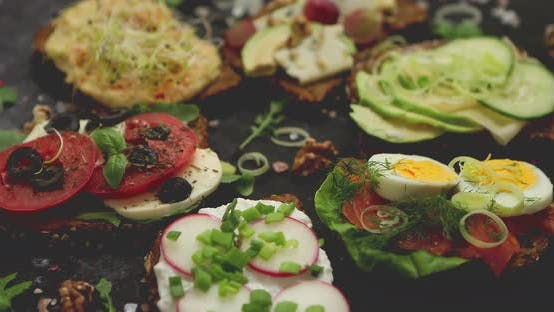 Thumbnail for Assortment of Home Made Sandwiches with Various Toppings. With Colorful Fresh Vegetables