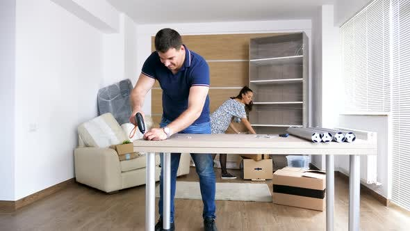 Thumbnail for Man Assembling Furniture in New House