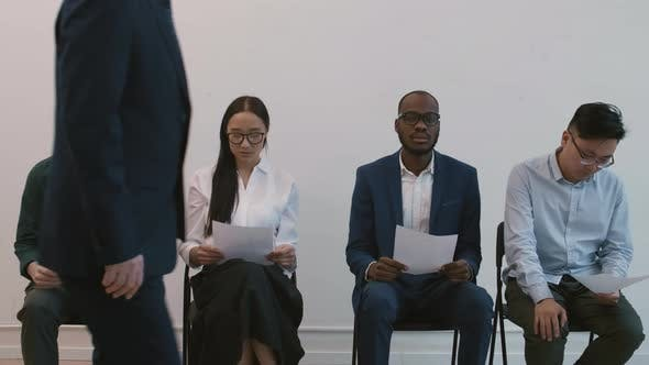 Impatient Diverse People Waiting for Interview