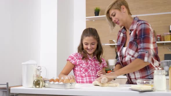 Thumbnail for Dolly Slider  Footage of Mother and Young Daughter Baking and Cooking Together at the Kitchen