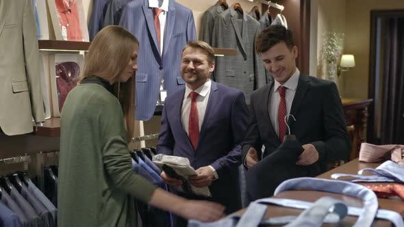 Thumbnail for Men Shopping in Menswear Clothes Store