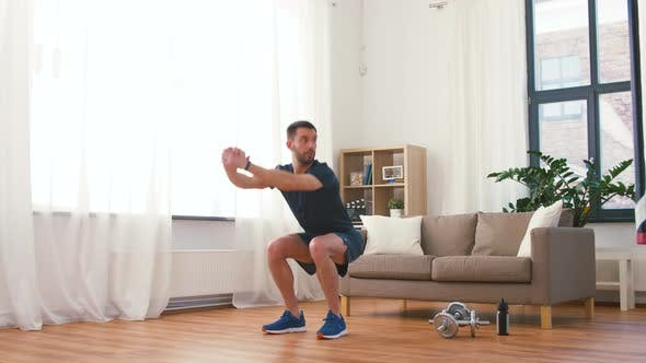 Thumbnail for Man Exercising and Doing Squats at Home 61