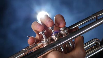 The Smoky Studio with Lighting Playing Trumpet