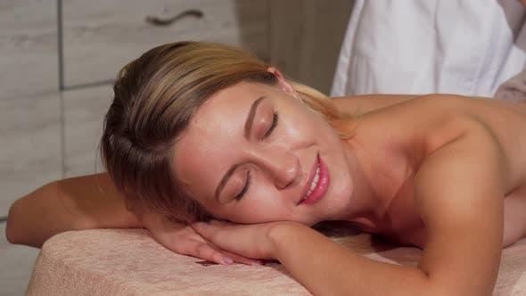 Thumbnail for Female Client Enjoying Relaing Body Massage at Spa Salon