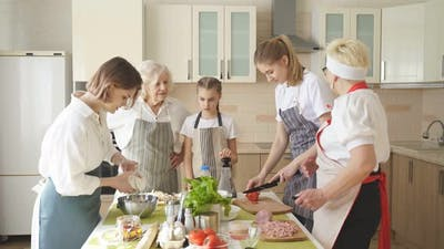 Happy Family Cooking Together on Kitchen