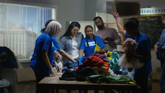 Thumbnail for Volunteer Team Packing Clothes