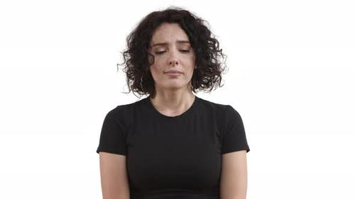 Attractive Caucasian Female Model with Short Hair Wearing Casual Black Tshirt Looking Sad and Gloomy