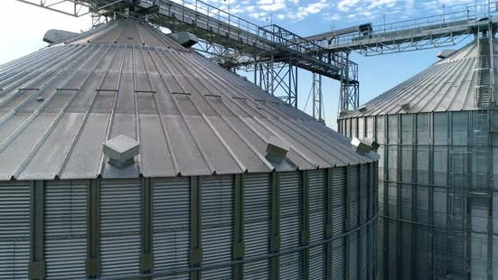 Thumbnail for Large silver granary. Modern grain elevators. Metal industrial silos for agribusiness.