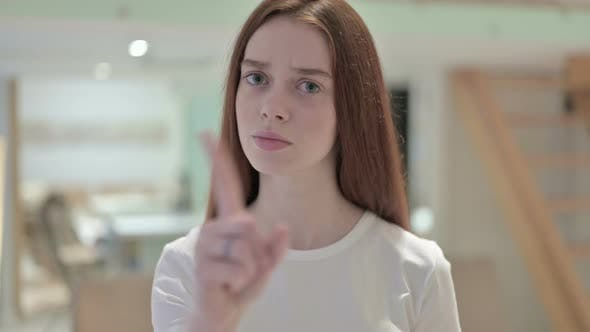 Thumbnail for Portrait of Attractive Redhead Young Woman Saying No By Finger