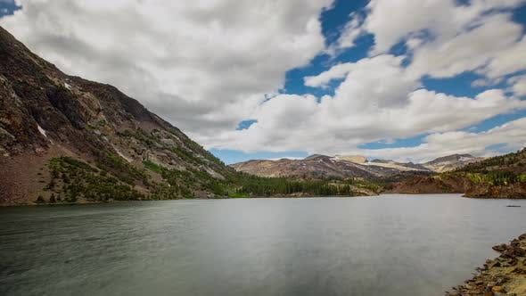 Thumbnail for Time Lapse of the clouds above a beautiful mountain lake