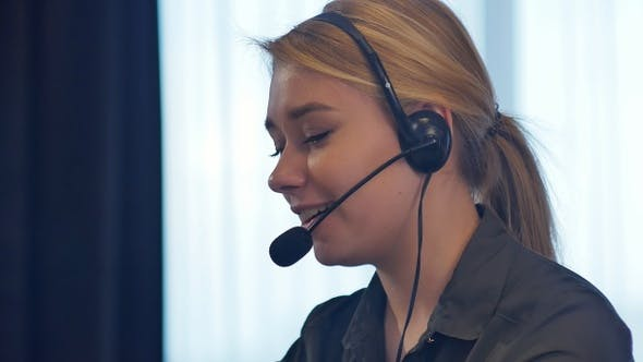 Thumbnail for Female customer support operator with headset talking and smiling