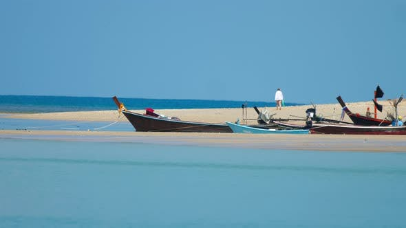 Cover Image for Longtail Fisher Boats on Beach