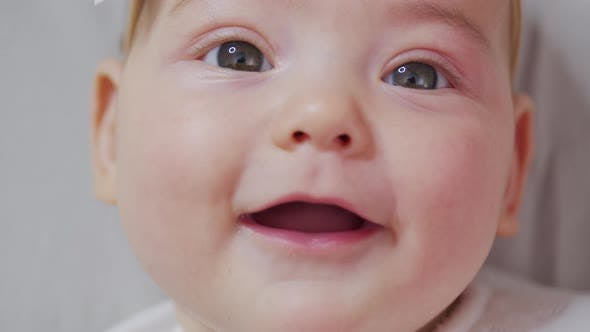 Thumbnail for Portrait of Sweet Little Baby Girl Smiles. Closeup