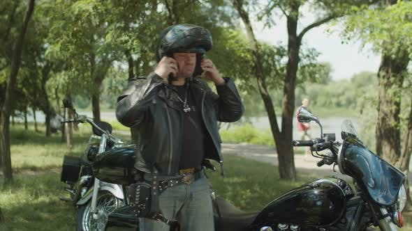 Thumbnail for Serious Biker Dressing Up Black Leather Jacket