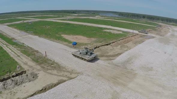 Aerial shot of tanks firing targets during playwar