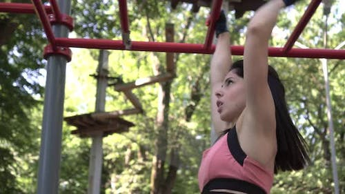 Sportive Woman Trains Hands on the Outdoor Sports Ground Workout and Fitness