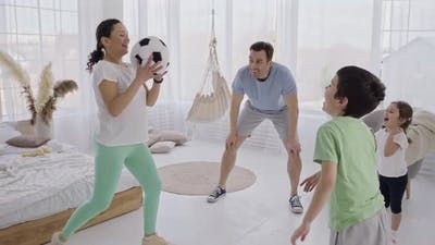 Happy Family Playing Ball with Kids at Home