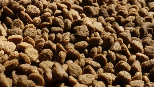 Thumbnail for Pile of cat or dog pellet meal close-up slow tilt 4K 2160p 30fps UltraHD footage - Protein rich  pet