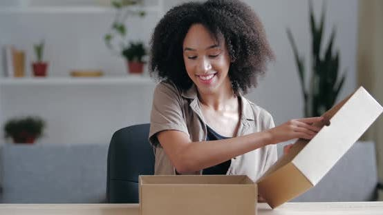 Thumbnail for Close Up Curly Haired Young Brunette Receives Parcel From Courier From Internet Store, Accepts