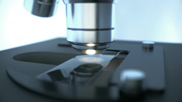 Laboratory Microscope Science Research Inspecting Chemical Drop on a Sample Slide Glass