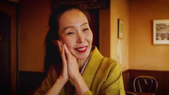 Elegant Japanese woman enjoying a coffee