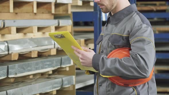 Cover Image for Cropped Shot of a Warehouse Worker Checking Inventory in Stock