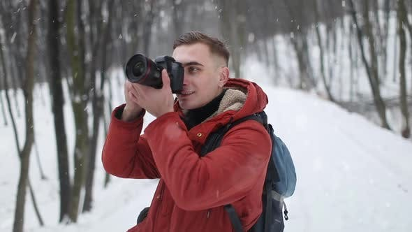 Thumbnail for Photographer Taking Photographs in Forest