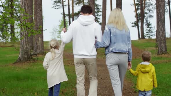 Thumbnail for Family of Four Walking in Forest