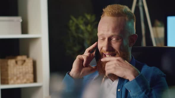 Thumbnail for Smiling Hipster Man Talking on Mobile Phone at Home. Happy Guy Working at Home.