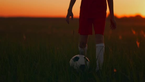 Thumbnail for Tracking a Boy Football Player Running with a Ball on Camera at Sunset