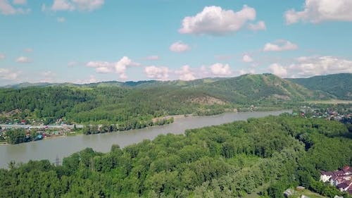Aerial Shot: Top View of Mountains, Pine and Deciduous Forest, Mountain River