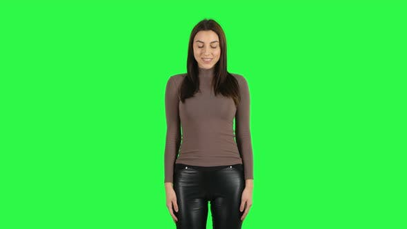 Cover Image for Attractive Girl Smiling While Looking at Camera. Green Screen