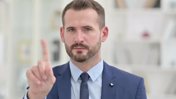 Thumbnail for Portrait of Businessman Saying No with Finger Gesture