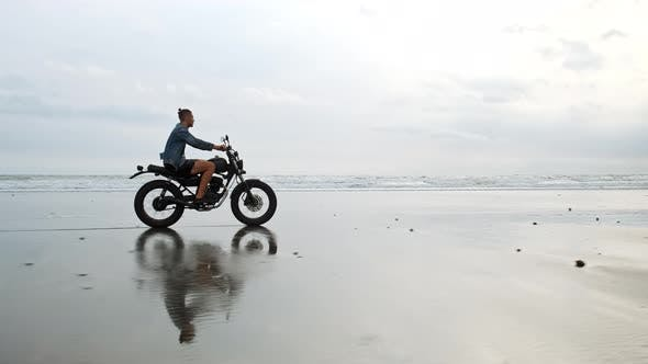 Thumbnail for Man in Riding Motorcycle on Beach. Vintage Motorbike on Beach Sunset on Bali