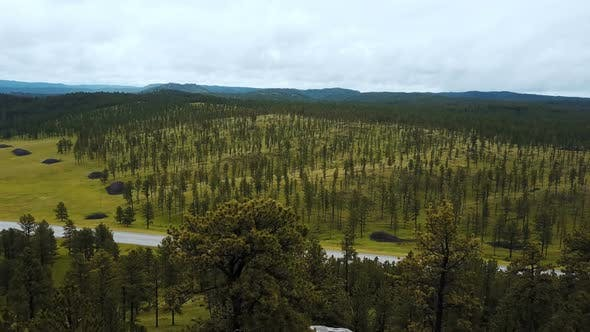 Thumbnail for Epic Aerial Drone Shot of Large Tree Covered Rocky Hills Revealing Incredible National Park Forest