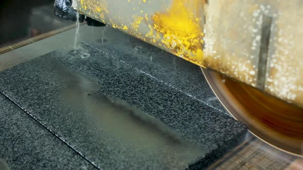 Thumbnail for Large Industrial Stone Cutter Cuts Ground Gray Granite on Tiles in Water Jets.