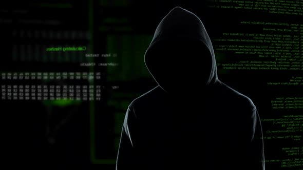 Thumbnail for Faceless Male Hacker in Hoodie Standing in Front of Animated Computer Code