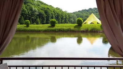 View of the forest, lake and tents.