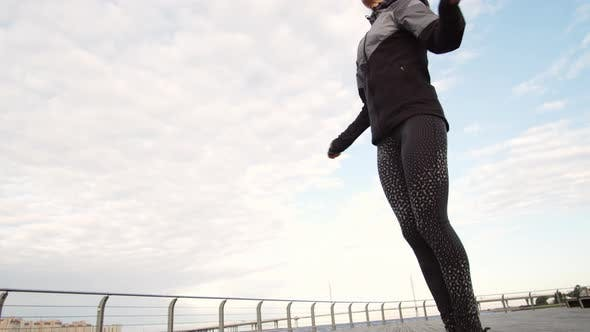 Thumbnail for Woman Exercising with Jump Rope in Morning